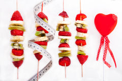 Fruit skewer. Fruit on a stick to a healthy diet Royalty Free Stock Photography