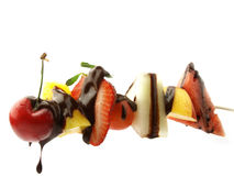 Fruit skewers with chocolate Stock Images