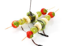 Fruit skewers and chocolate Stock Photography