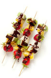 Fruit on the skewers with chocolate Royalty Free Stock Photos