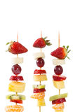 Fruit skewers. Delicious natural fruit skewers with white background Royalty Free Stock Photos