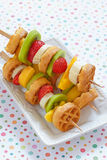 Fruit skewers on a dish Royalty Free Stock Photography