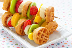 Fruit skewers on a dish Stock Image