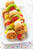 Fruit skewers on a dish Royalty Free Stock Image