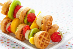 Fruit skewers on a dish Stock Images