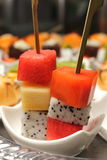 Fruit skewers with a dish Healthy party food. Stock Photos