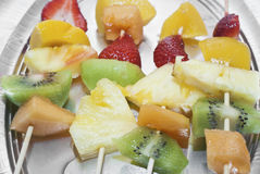 Fruit skewers. Mixed fruits on skewers close-up Royalty Free Stock Photos