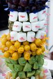 Fruit skewers on sticks of square form. closeup on delicious fru. Fruit skewers on sticks of square form. closeup on delicious stock photos