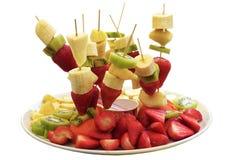 Fruit skewers strawberries, kiwi, banana, apple Royalty Free Stock Photos