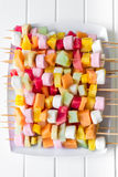 Fruit skewers on a white plate Royalty Free Stock Photo