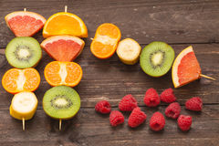 Fruit skewers on the wooden background. / the concept of healthy lifestyle Royalty Free Stock Photos