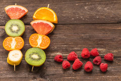 Fruit skewers on the wooden background / the concept of healthy lifestyle with place for text Royalty Free Stock Photography