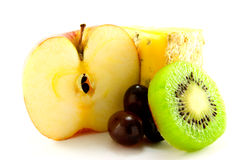 Fruit with Slice of Cheese. Apple, kiwi, grapes and a slice of cheese with clipping path on a white background Royalty Free Stock Images