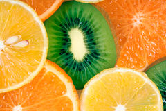Fruit slices background (lemon, kiwi, tangerine) Stock Images