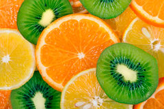 Fruit slices background (lemon, kiwi, tangerine) Royalty Free Stock Photo