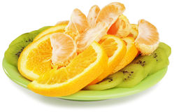 Fruit slices on plate Royalty Free Stock Images