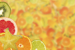 Fruit slices on yellow background Stock Photography