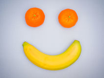 Fruit smile. Face made of banana and tangerines Royalty Free Stock Images