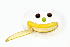 Fruit smiley. Good health snack grape banana white background Stock Photography