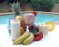 Fruit Smoothie. Selection of summer smoothies by the pool Royalty Free Stock Photo