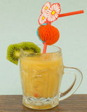 Fruit smoothie of banana, orange, kiwi and tangerine Stock Image