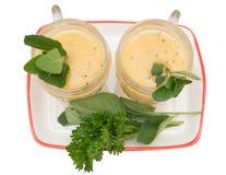 Fruit smoothie of banana, orange, kiwi and tangerine Royalty Free Stock Image