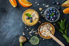 Fruit smoothie with ingredients on the stone table Royalty Free Stock Image