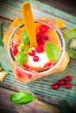 Fruit smoothie kiwi orange red currants Stock Photos