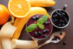 Fruit smoothie with mint leafs Royalty Free Stock Image