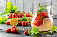 Fruit smoothie with strawberries and lemon Stock Images