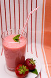 Fruit smoothie and strawberries Royalty Free Stock Photo