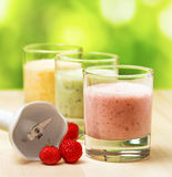 Fruit smoothie on wooden table on narural backgrou Royalty Free Stock Images