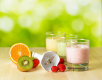 Fruit smoothie on wooden table on narural background Stock Photography