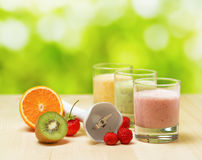 Fruit smoothie on wooden table on narural background Stock Photos