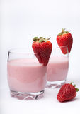 Fruit smoothie yogurt with ripe strawberries on the white backgr Royalty Free Stock Photography
