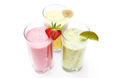 Fruit smoothies. Strawberry, banana and kiwi smoothies isolated on a white background Royalty Free Stock Images