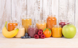 Fruit smoothies for a baby Stock Images