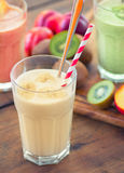 Fruit Smoothies. With fruits on ooden table Royalty Free Stock Photography