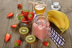 Fruit smoothies in jar. On a white background royalty free stock photography