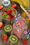 Fruit smoothies in jar. On a white background stock photography