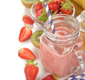 Fruit smoothies in jar. On a white background royalty free stock images