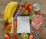 Fruit smoothies in jar. On a wooden background royalty free stock photography