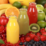 Fruit smoothies made from oranges, strawberries and kiwi Royalty Free Stock Photo
