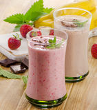 Fruit smoothies with  strawberry and banana on  a wooden table. Royalty Free Stock Photo