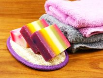 Fruit soap with bath items and towel on wooden background Royalty Free Stock Image