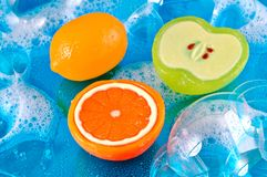 Fruit Soaps in Bubbles Stock Images