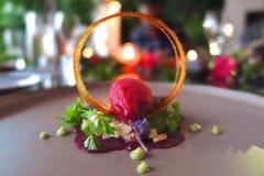 Fruit sorbet dessert with spun caramelized sugar Stock Photos