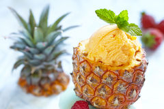 Fruit sorbet ice cream in small pineapple. Small pineapple stuffed fruit sorbet ice cream stock photography