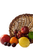 Fruit spilling out of cornucopia Royalty Free Stock Image