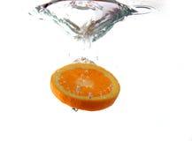 Fruit splash. Orange fruit splashing in water Royalty Free Stock Photos